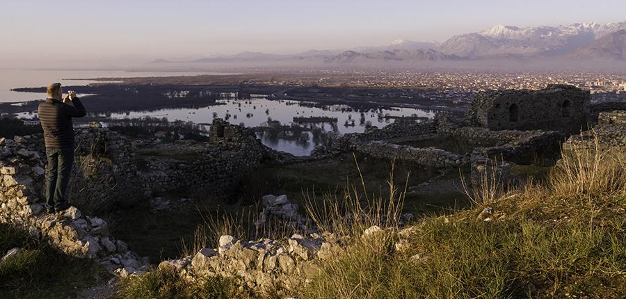 027 Man shooting photo of city from Rozafa Castle of Shkodra, Albania, 2015