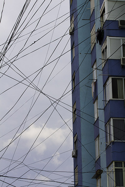 27 Street scene with building and wires in Tirana, Albania, in 2014