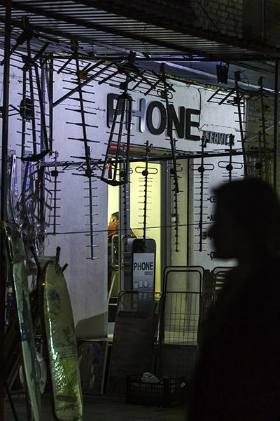 08 Street scene, phone shop in Tirana, Albania, in 2014