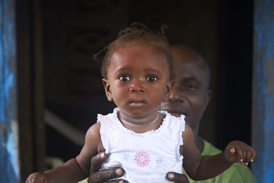 Shopkeeper with child, West Point settlement --Monrovia, Liberia