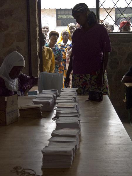 17 Woman presenting registration to vote in Buturere, Bujumbura Rural Commune, Burundi, in 2005