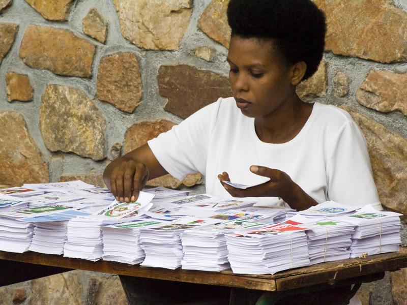 14 Woman preparing voter ballot packs in Buterere, Bujumbura Rural Commune, Burundi, in 2005