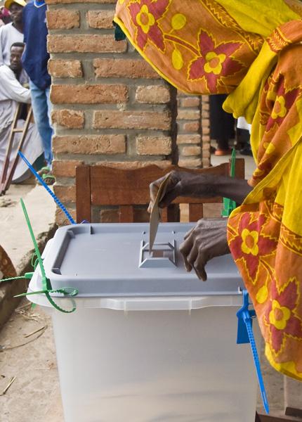 20 Woman placing ballot envelope into box in Buterere, Bujumbura Rural Commune, Burundi, in 2005