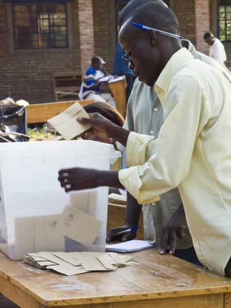 26 Man counting ballots after the closing of  legislative elections in Buturere, Bujumbura Rural Commune, Burundi, in 2005