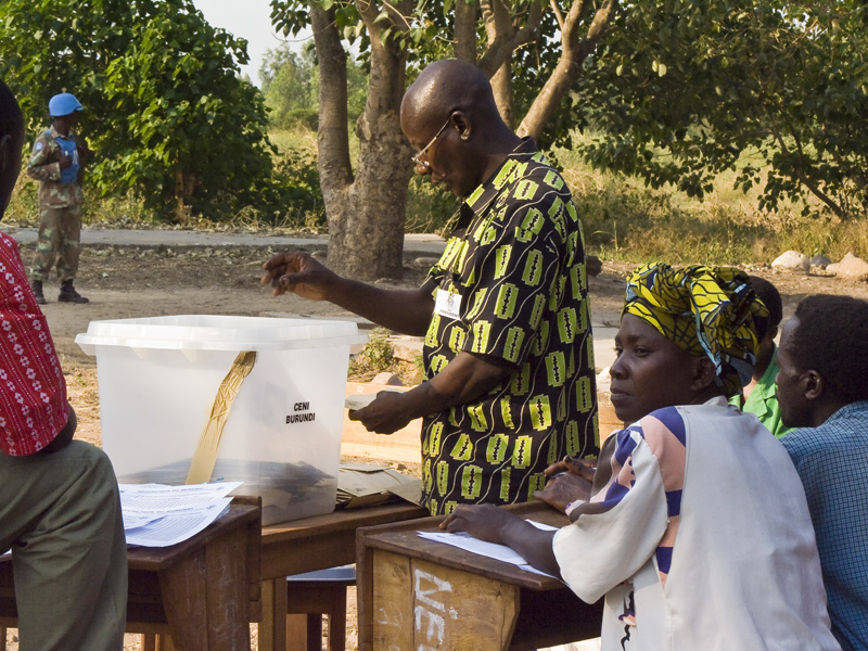 27 Votes being counted in front of party representatives in Buterere, Bujumbura Rural Commune, Burundi, in 2005