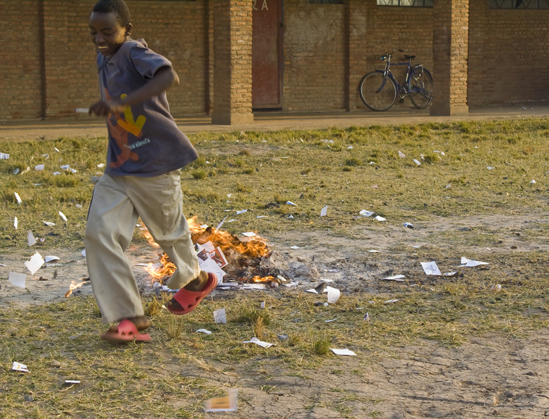 30 Counted ballots being burned by child in Buturere, Bujumbura Rural Commune, Burund, in 2005