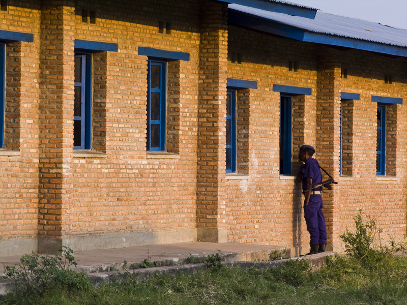 29 Officer observing ballot count through window in Buturere, Bujumbura Rural Commune, Burundi, in 2005