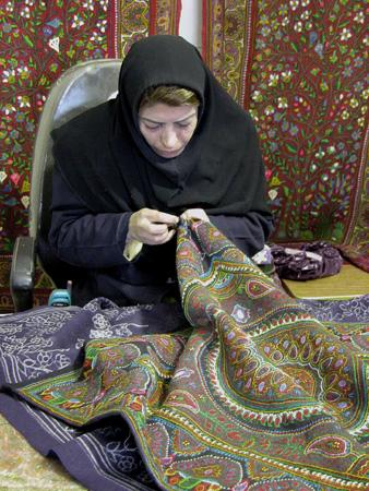 "Woman embroidering a ""pateh"" Kerman, Iran"