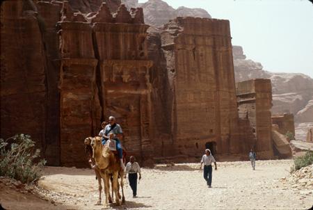 Tourists enjoying camel ride through Outer Siq Petra, Jordan