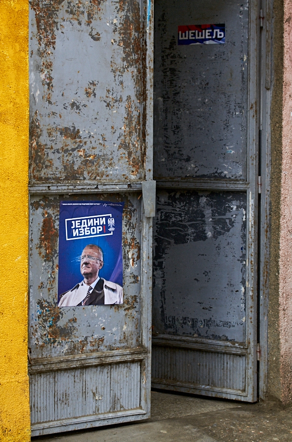 026 Political poster on door in North Mitrovica, Kosovo, 2016